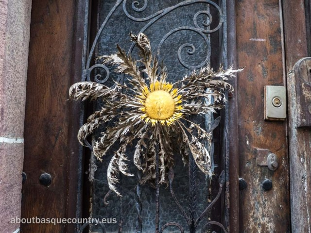 An eguzkilore, or carline thistle, on the door of a Navarrese home