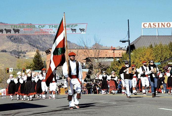 The Oinkari Basque dancers of Boise carry their culture's banner in the Trailing of the Sheep Parade. The city has the largest Basque community in the United States. Express photo by Roland Lane