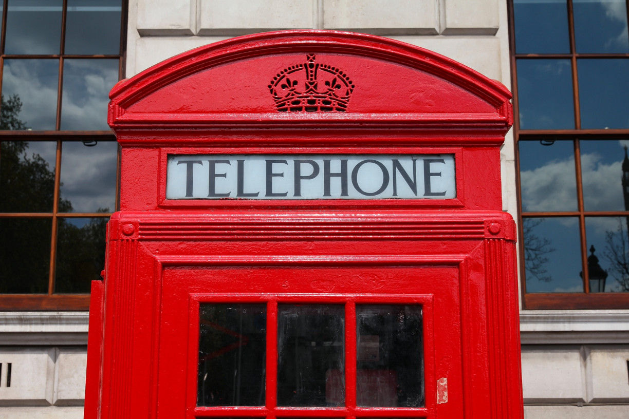 London, United Kingdom - red telephone booth typical for England.