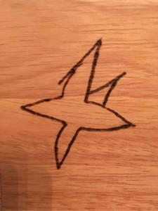 Stern mit einem nachträglich gemalten Zacken - die Vorlage des Sohnes