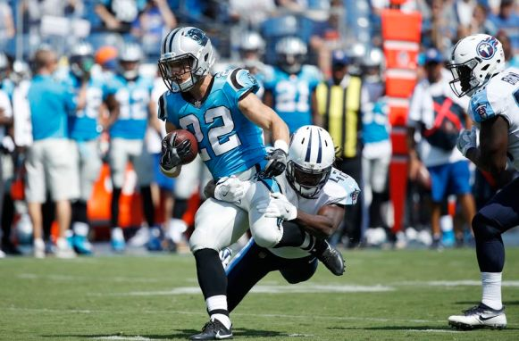 NASHVILLE, TN - AUGUST 19: Christian McCaffrey #22 of the Carolina Panthers runs through a tackle attempt by Denzel Johnson #42 of the Tennessee Titans in the second quarter of a preseason game at Nissan Stadium on August 19, 2017 in Nashville, Tennessee. (Photo by Joe Robbins/Getty Images)