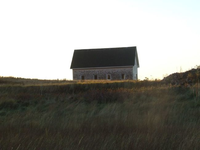 A classic cottage perched on a hill in Cape Breton, Nova Scotia.