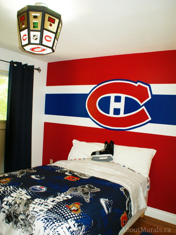 A hockey bedroom painted in Montreal Canadiens theme by Adrienne of AboutMurals.ca