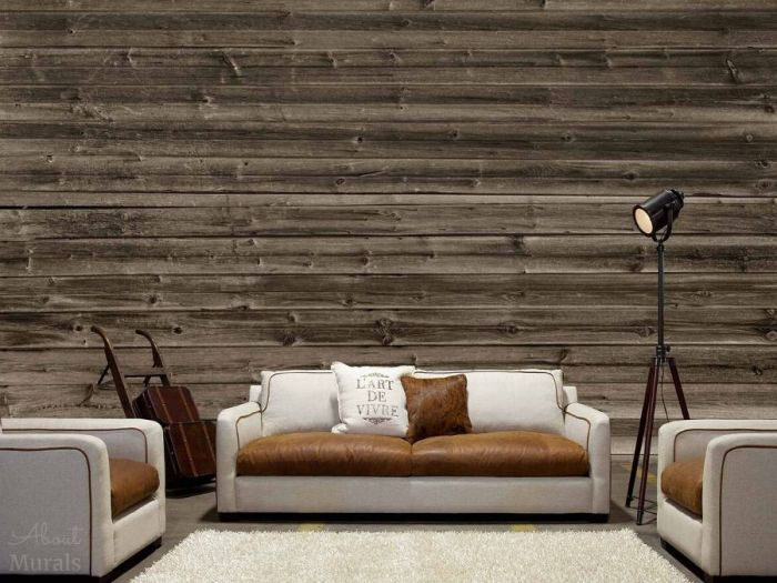 Horizontal Barn Wood Wallpaper, as seen in this living room, creates a rustic, textured look on walls with its brown reclaimed wooden planks. Wood wallpaper sold by AboutMurals.ca.