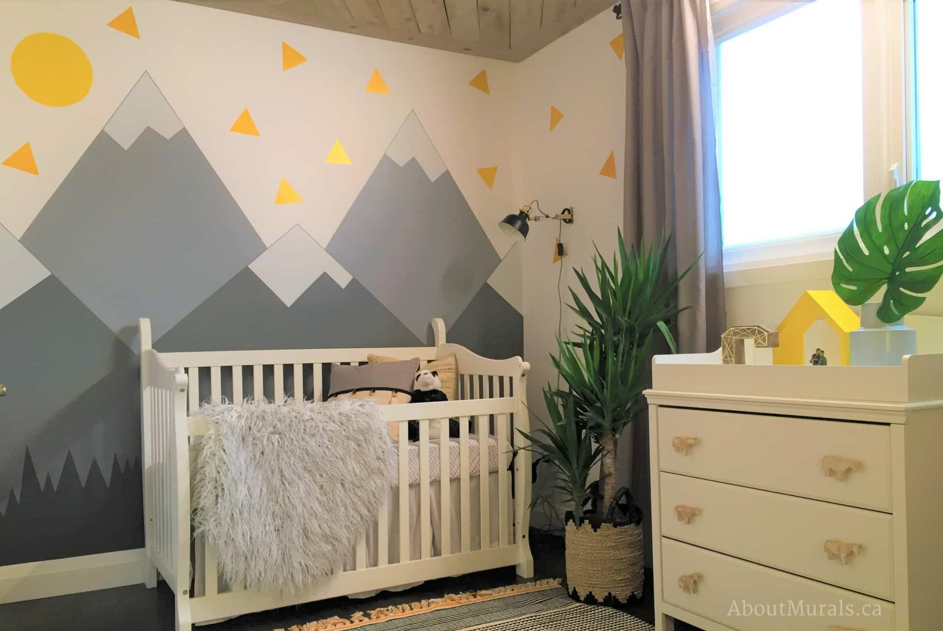 A kids wall mural painted in a mountain themed nursery by Adrienne of AboutMurals.ca