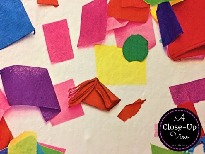 A close-up photo of colourful confetti wallpaper sold by AboutMurals.ca