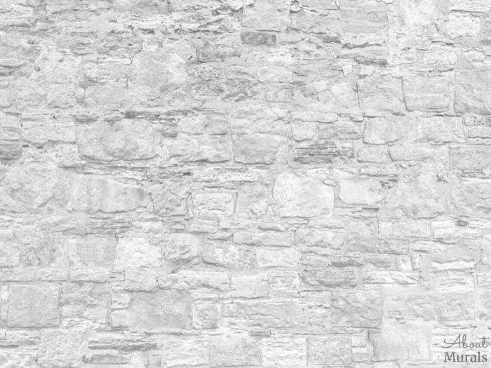 White Stone Wallpaper creates an airy feel with its stacked stone wall. Stone wall murals sold by AboutMurals.ca.