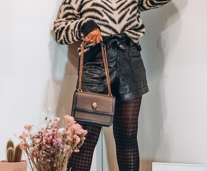 leather shorts and zebra printed sweater