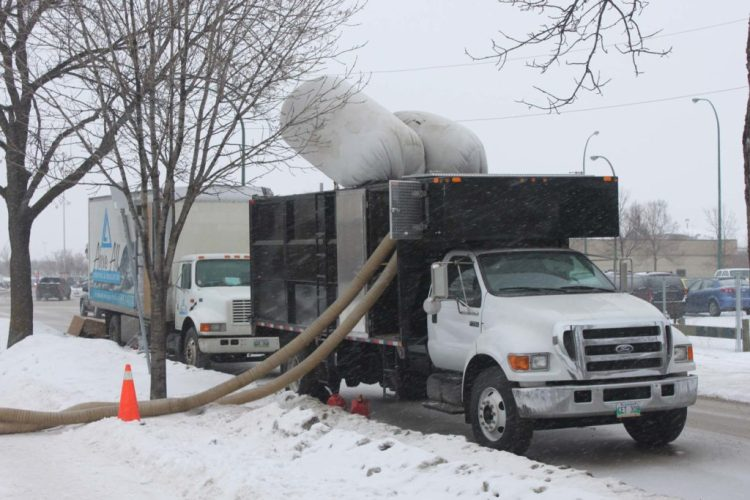 Evacuation truck vacuuming out existing insulation