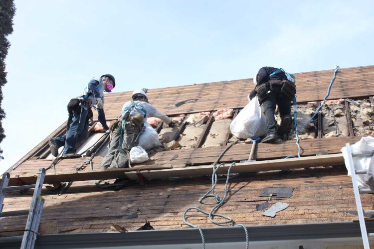 Above All roofers on roof