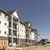 Installing siding on Winnipeg multi-family commercial project