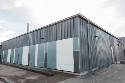 Custom modern siding on Winnipeg industrial building
