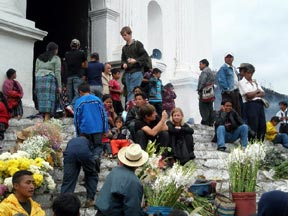 People gathered on the steps of the Church of Santo Tomas