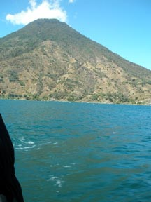 A view of a volcano taken from a boat on Lake Atitaln