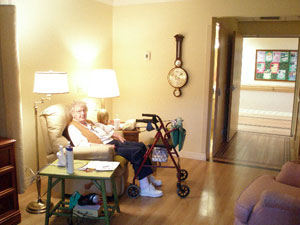 Mother sitting in recliner in her new room