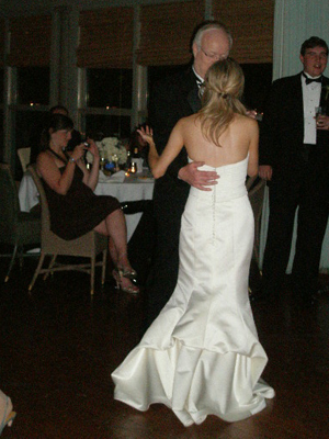Emily dances with her father