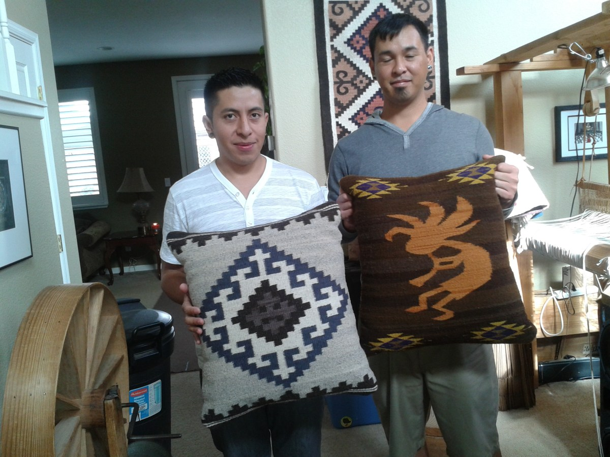 Jaime and Joey with handwoven cushions