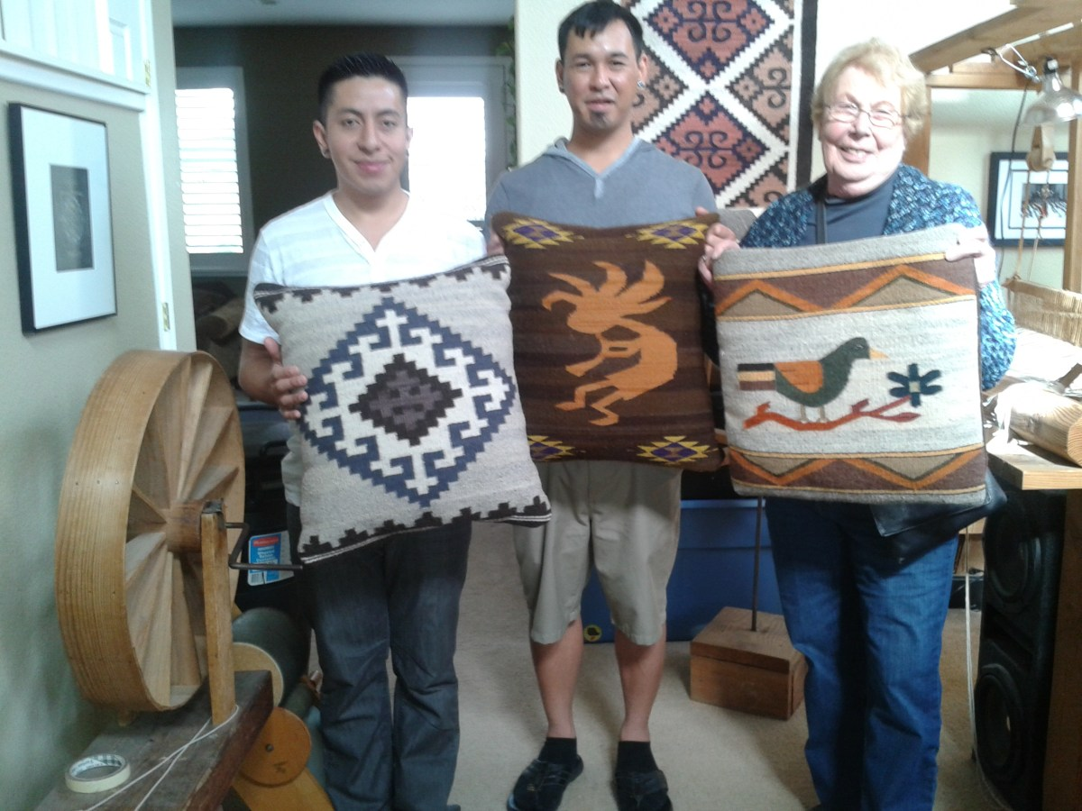 Jaime, Joey and Ev show some tapestry cushions