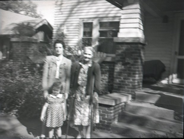 Mother, Grandma Williams with me in front of the 41st Street house