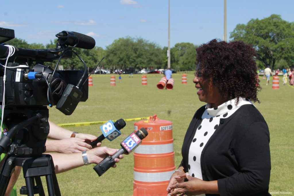 Above Promotions client interviewed by tv stations at event Tampa FL