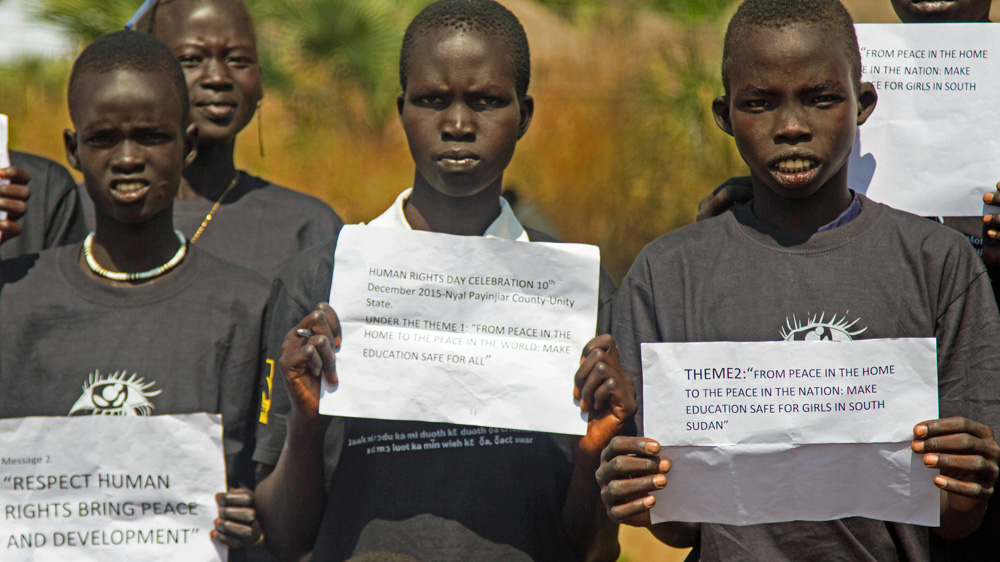 Schoolchildren joined an awareness campaign for women's rights organised by the International Rescue Committee in Nyal [Caitlin McGee/Al Jazeera