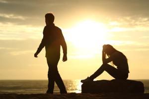 man-walking-away-from-sad-woman