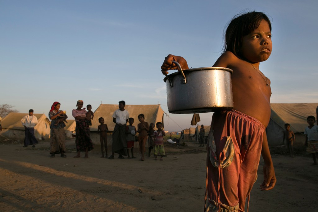 24 November, 2012: A young Rohingya girl carries water to her tent at a IDP camp on the outskirts of Sittwe, MyanmarPaula Bronstein/ Getty Images