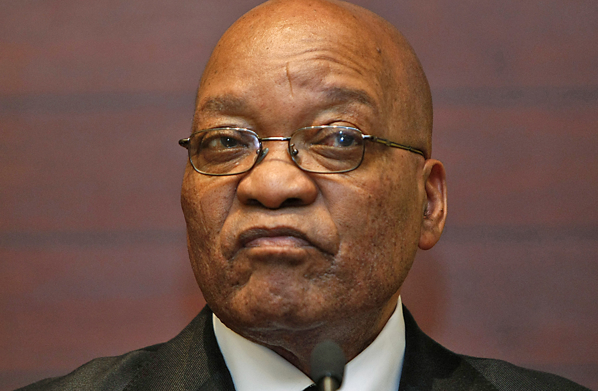 South African President Zuma listens as Swedish PM Reinfeldt addresses a news conference after their meeting in Cape Town