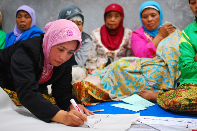 In Yogyakarta, Indonesia, women at a community meeting discuss the reconstruction of their village in the wake of the 2006 tsunami and earthquake. Photo: World Bank/Nugroho Nurdikiawan Sunjoyo