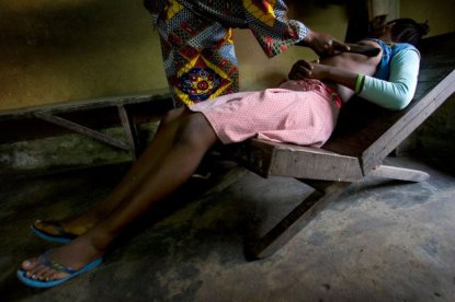 BG8391 Girl gets breasts ironed, Douala, Cameroon.