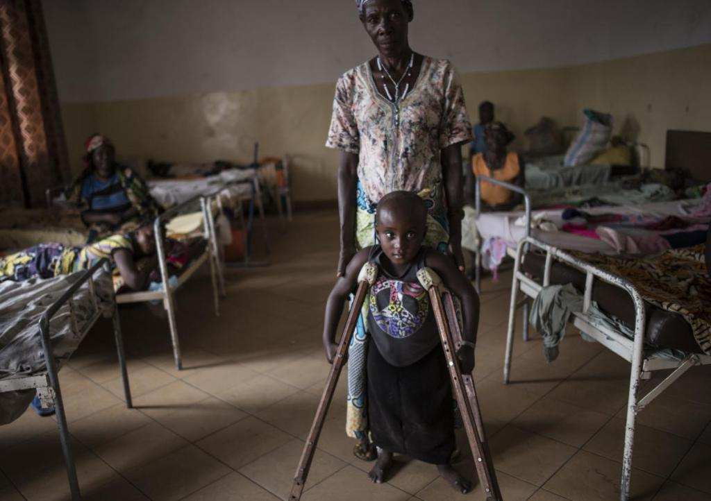 Kanyere Neema, 7, is held up by her grandmother, Ndahondi Domina, 53, as she poses for a portrait in the Heal Africa hospital in Goma, in the Democratic Republic of Congo, December 5, 2015. Two years prior, Kanyere's village of Ishasha was attacked by armed men, and her parents were killed in front of her; she was raped so many times by various men that she was left paralyzed, and stopped speaking. As the world takes more notice of rape being used as a weapon of war, congos dark history of sexual violence in conflict has much to teach the world on how to prevent rape, and how it can help survivors heal physically, emotionally, and socially. (Credit: Lynsey Addario for Time Magazine) Kanyere's story: Ishasha, near Uganda border. Kanyere came here when she was 5. In ishasha fdlr right before harvest and cause panic and trouble and rape people and terrorisE so people run away and they can steal the harvest. When they came l, they killed the father and mother, and the grandmother luckily was out of the village at the market. They killed so many people, it wasn't only kanyere's parents who were killed, they raped her. It was difficult to estimate how many men raped her because she was left paralysed. After she was brought here, we treated her, she had big wounds, she had fistula and a lot of things. After she finished the treatment she was sent back home. Then the grandmother brought her back for supports and the project to give support is over. I can't say she is healed. She doesn't control her urine and when she has to go caca. To me it's not about psychological issue, it's about physical issue, and she was raped by adults when she was still very young. Why would people rape a 5 year old girl: first it is because those predators have no mercy. The other thing is to make people hurt themselves Forcing people to hate themselves, hate their country, to hate everything. Once you have been raped, you don't have feelings of being human. You just want Grandmother: