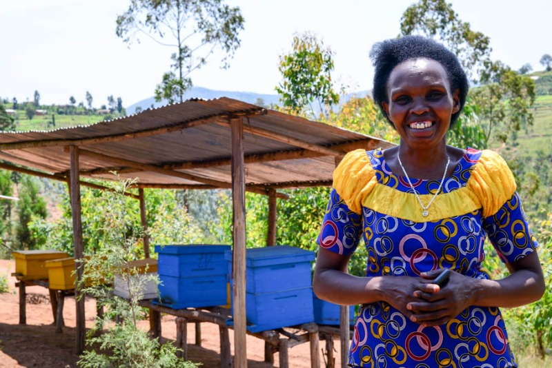 WfWI-Rwanda graduate Caritas at her beekeeping cooperative Abafitintego. Photo credit: Harriet Tolputt, 2016