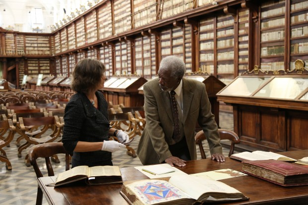 ROME – Morgan Freeman examines ancient documents with Cornell University Professor of Ancient Mediterranean Religions Kim Haines-Eitzen at the Biblioteca Casanatense in Rome, Italy.