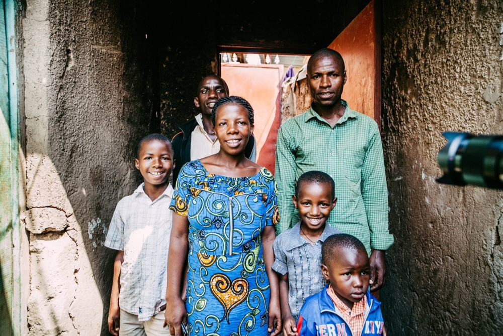 Mamerica and her family standing proudly outside their home