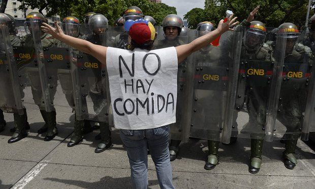 Facebook Twitter Pinterest A woman with a sign reading 'There is no food' protests against new emergency powers decreed by President Nicolás Maduro on 18 May. Photograph: Federico Parra/AFP/Getty Images