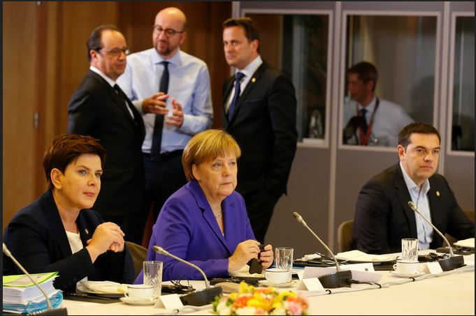 Chancellor Angela Merkel of Germany, center, with leaders from Belgium, France, Luxembourg, Poland and Greece, during a round-table meeting in Brussels on Wednesday. Credit Pool photo by Pascal Rossignol