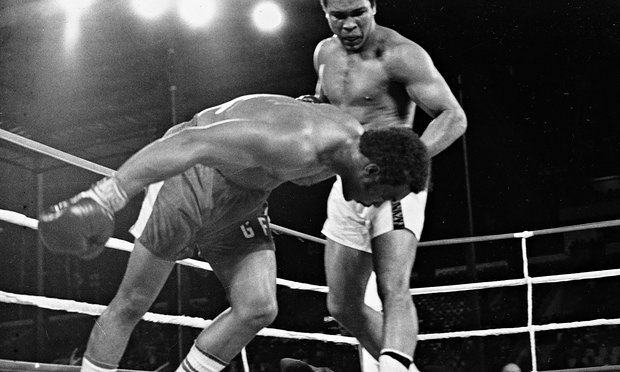 Muhammad Ali watches as defending world champion George Foreman goes down on the canvas in the eighth round of the Rumble in the Jungle. Photograph: Red/AP