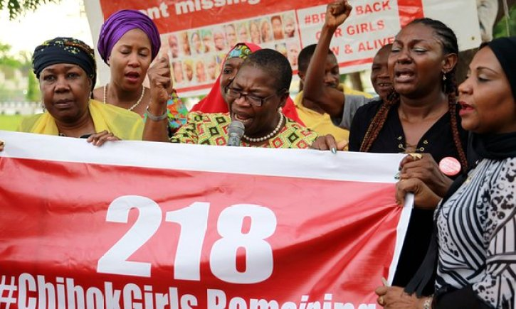 #BringBackOurGirls campaigners with an updated poster after the news that a teenager kidnapped from Chibok more than two years ago has been rescued. Photograph: Afolabi Sotunde/Reuters