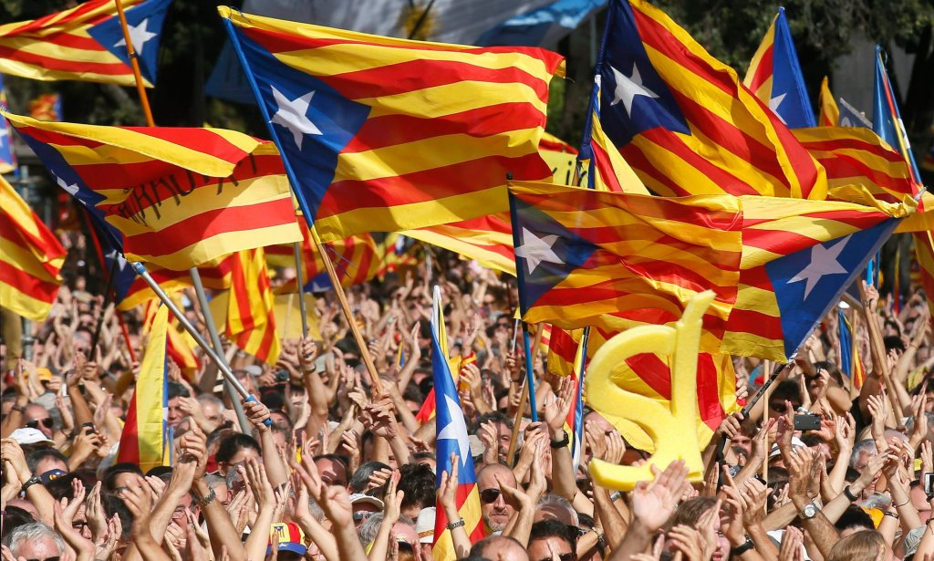 People wave Catalonia flags at a rally in Barcelona. A recent poll showed that 47.7% of Catalans support independence. Photograph: Albert Gea/Reuters
