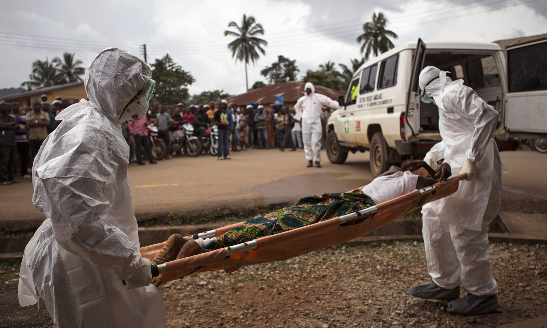 Healthcare workers carry a suspected Ebola sufferer to an ambulance in Kenema. Photograph: Tanya Bindra/AP