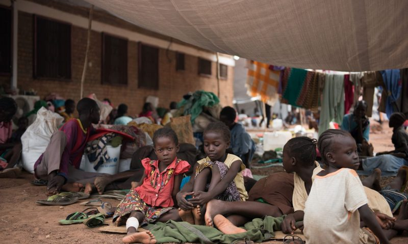 Children wait to be registered among the displaced in a South Sudan Red Cross compound in Wau, where violence broke out in breach of a peace deal. Photograph: Charles Lomodong/AFP/Getty Images