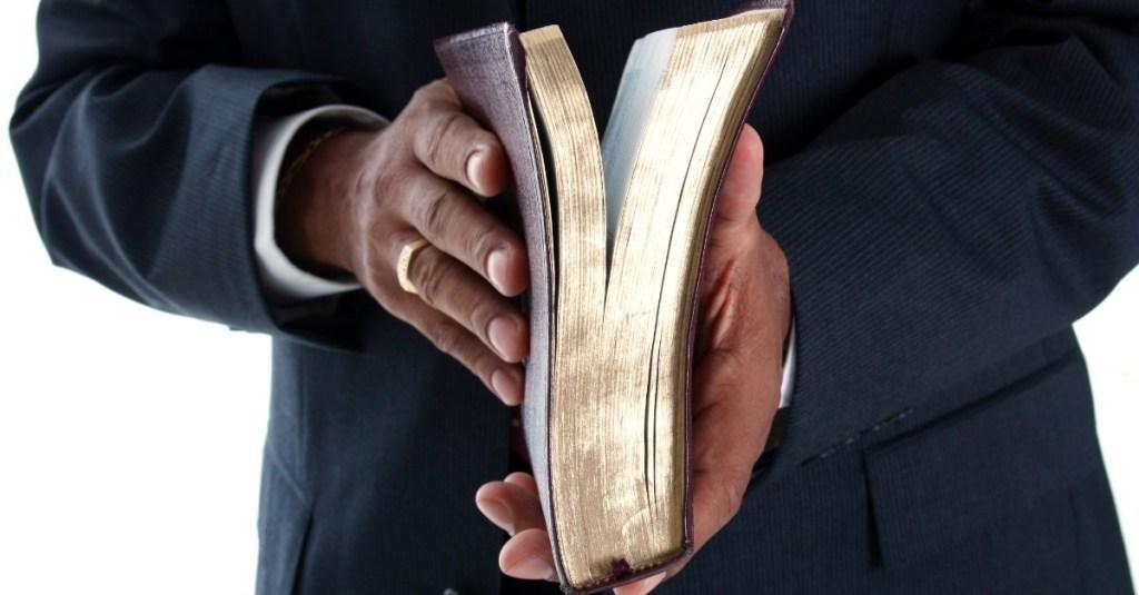 Bible-holdingBible