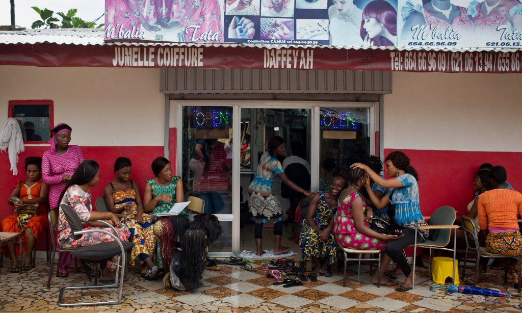 Female clients at the Jumelle Coiffure hair salon in Conakry benefit from free contraceptives as well as family planning advice dispensed by apprentice hairdressers trained as community health workers. Photograph: Kate Holt