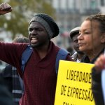 Demonstrators shout slogans and hold placards saying 'Expression of freedom in Angola' in March. Photograph: Joao Relvas/EPA