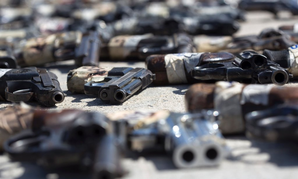 Hundreds of firearms are displayed before being destroyed at the Morelos military headquarters in Tijuana, Mexico. Photograph: Guillermo Arias/AFP/Getty Images