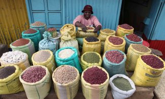 A woman prepares grains at her shop in the Kibera slum in the Kenyan capital of Nairobi, 2012. Photograph: Noor Khamis/Reuters