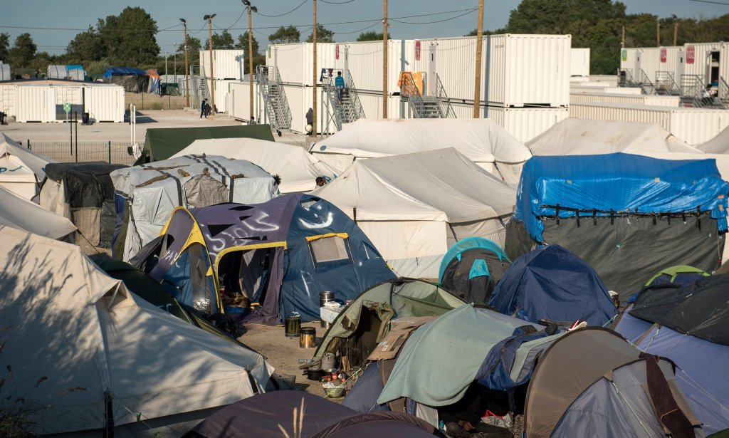 The tents and white metal containers housing refugees in Calais. Photograph: Alecsandra Raluca Drăgoi for the Guardian