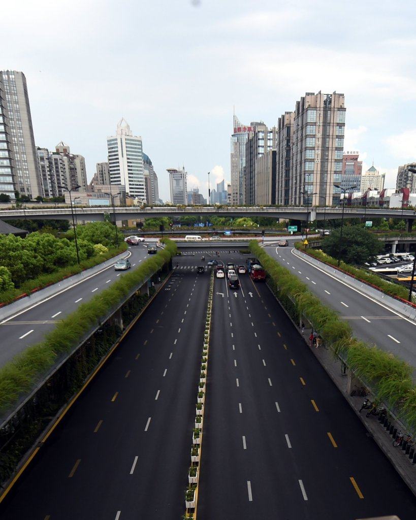 West Lake Road in Hangzhou. Hangzhou has been massively upgrading the city's infrastructure with such improvements as repaving roads, expanding its subway system and dredging waterway for the G20 summit. Photograph: Xinhua / Barcroft Images