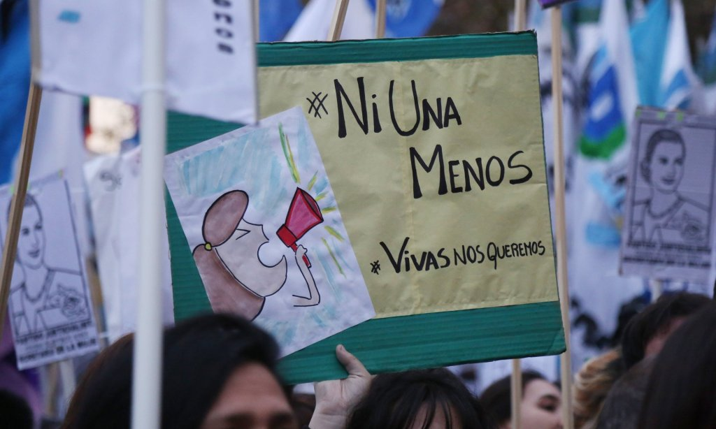A protester holds a placard bearing the words 'Ni Una Menos' – 'Not one less' – at a June women's rights rally in Buenos Aires. Peruvian campaigners are to stage a similar protest. Photograph: Omer Musa Targal/Getty Images