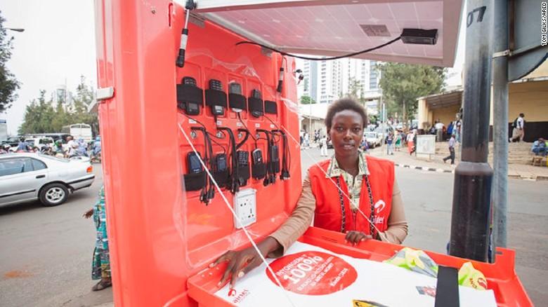 Solar kiosk franchisee, Jeanne Marie Uhiriwe, on the streets of Kigali, Rwanda.